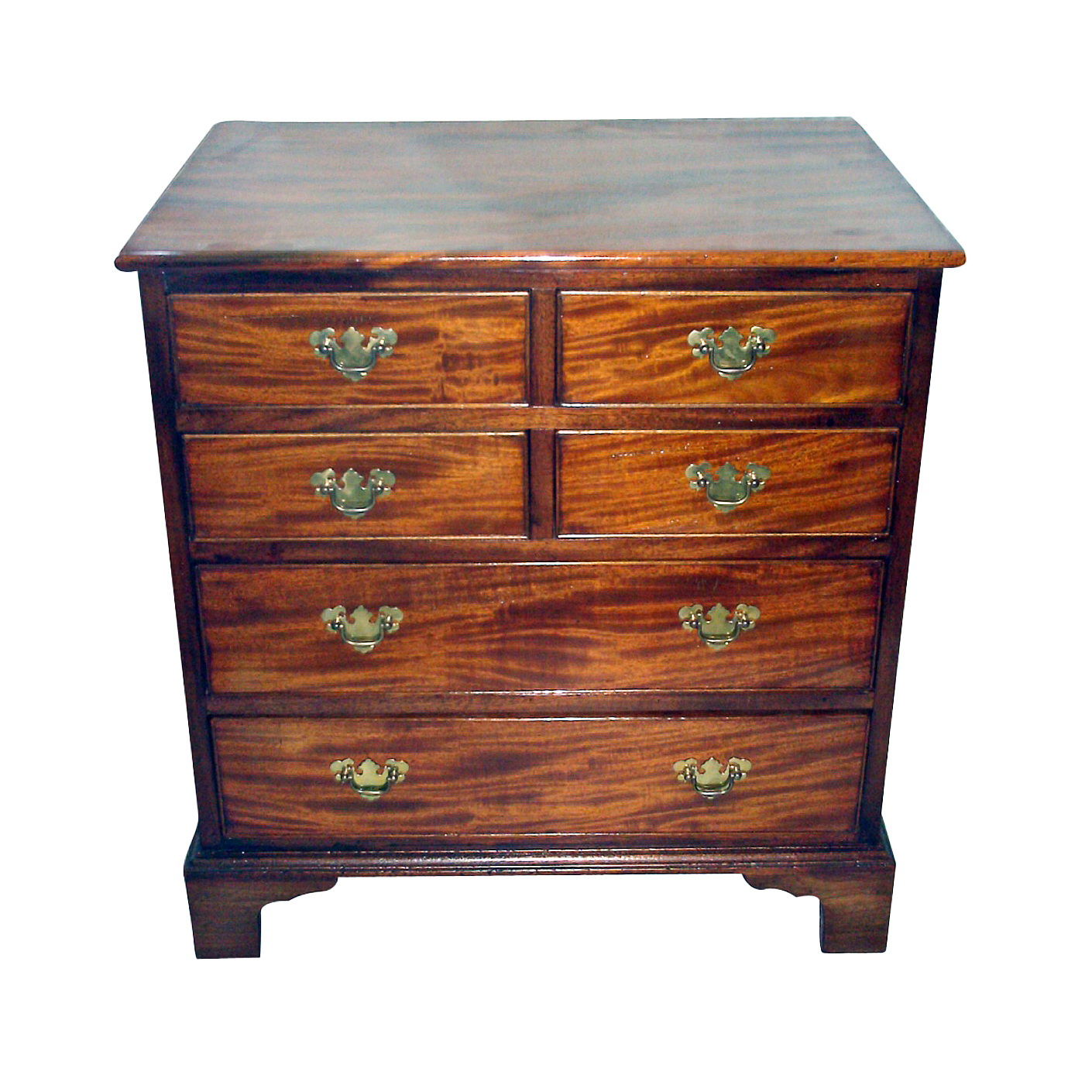 This diminutive Georgian style chest of drawers was probably scaled down from a larger antique case piece. It has appropriate but modern hardware and is French polished and retail ready. It has a one board top of beautiful plum pudding mahogany and would make a perfect side table or bedside stand.